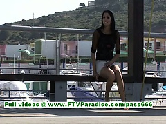 Suri superb brunette teenage flashing and fingering pussy in a public place