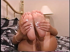 Sexy blond in zebra print dress and no panties sucks her feet and uses dildo