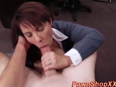 Amateur milf bitch sucks cock in a pawn shop