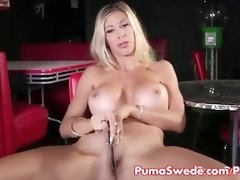 MIlf is stimulating her pussy with a metal object