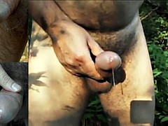 Kinky gay boy touches his precum in the woods