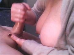 Busty Granny gives an amazing Handjob