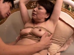 Restrained Japanese granny braces herself for a deep fucking