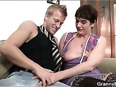 Granny in sexy stockings sucks dick