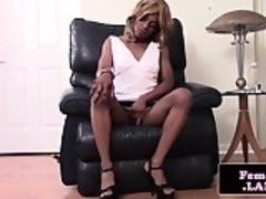 Heeled black femboy masturbating