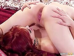 Sexy redheaded milf dominates a delicious young lesbian