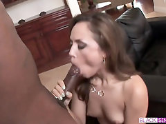 Kristina Rose is too engaged deepthroating her dark-hued paramour's meatpipe to think of anything else