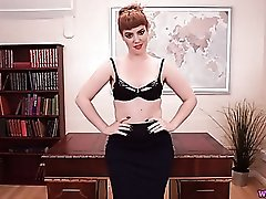 Redheaded teacher offers a dirty talking striptease