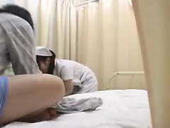 Enticing Asian nurse with a pretty smile in on the prowl of