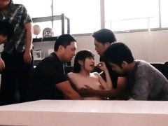 Adorable Oriental teen has a group of boys sharing her pussy