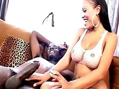 Big meloned ebony charmer Lacey Duvalle smoking and sucking a monster black dick on the couch