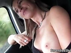 Busty Milf gets on her knees sucking a huge dick