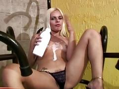 Tgirl pours milk on her bubble butt and teases solo