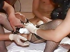 Submissive slut fist fucked by three masked brutes