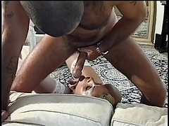 Shaved head guy fucks transsexual on couch