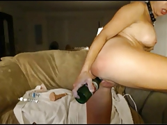 Slut fucks a bottle, stuffs her panties and squirts