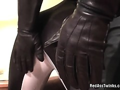 Nasty guy in rubber clothes gets ass spanked by horny gay